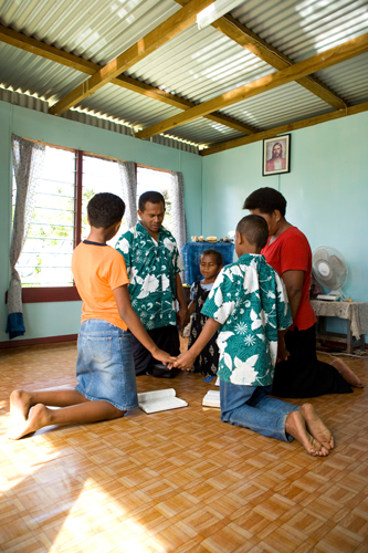 Family in Fiji praying