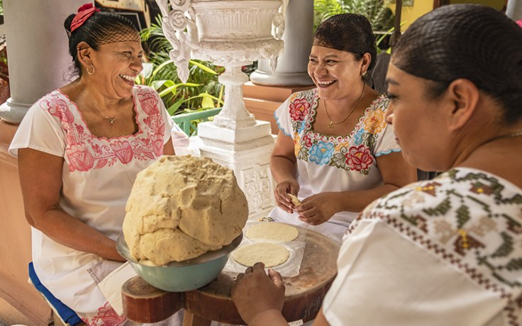 Women making tortillas together, a traditional food in Mexico