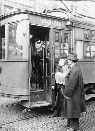 people wear masks on trolleys during the 1918 Spanish Flu pandemic.