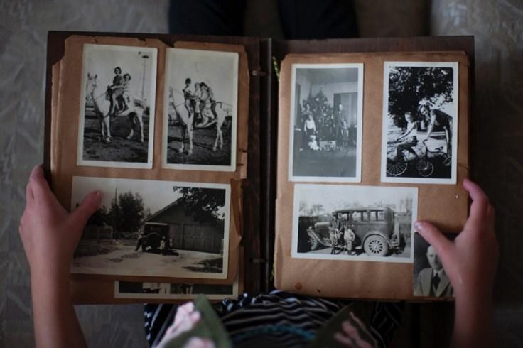 a photo album showing historic photos