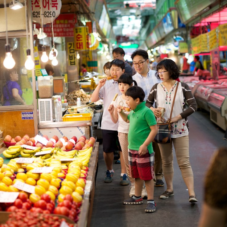 Asian family eating traditional foods at the market.