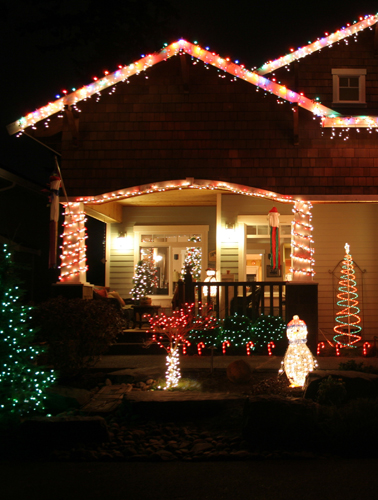 a house lit up with Christmas lights.