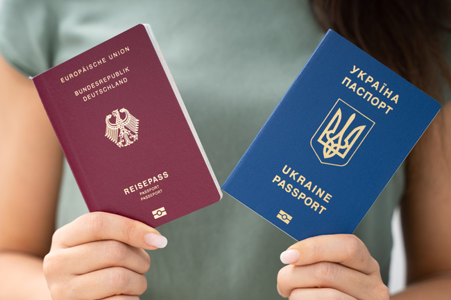 Woman holding two passports.