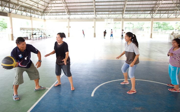 a group plays basketball together