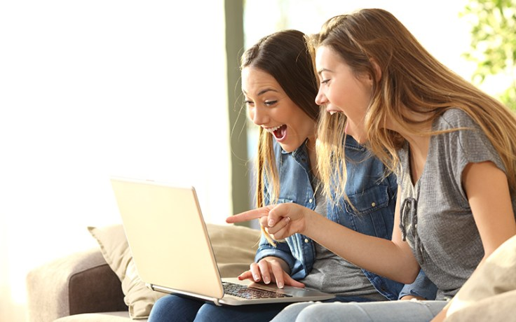 two girls on a computer.