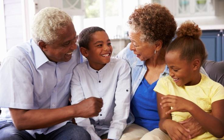african american grandparents speak with their grandchildren.