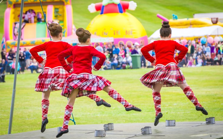 dancers perform at the highland games.