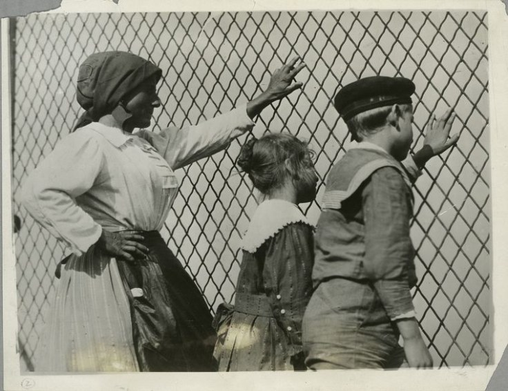 US immigrants putting hands on fence