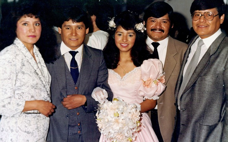 A quinceañera with her family