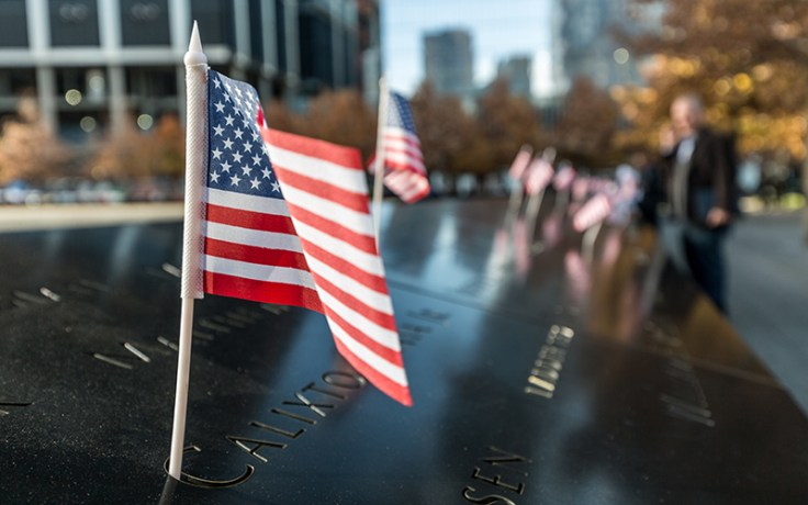 an american flag on the 9/11 memorial, in order to remember 9/11
