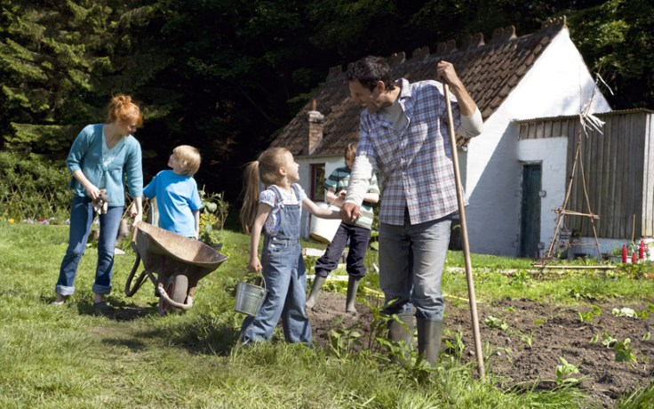 a family works together outdoors.