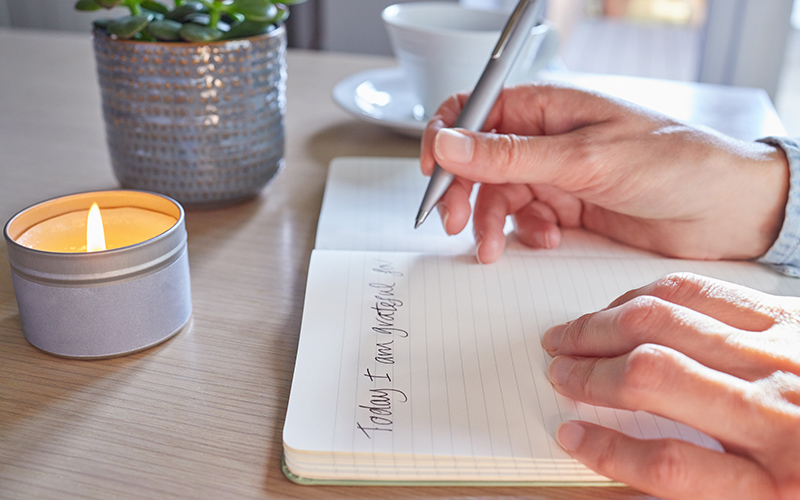 A man starts writing in a journal.