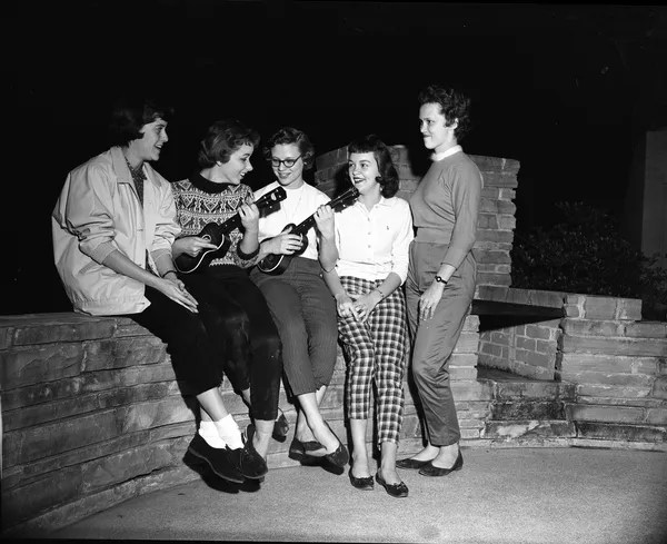 teenagers dressed in 1950s casual clothing and fashion