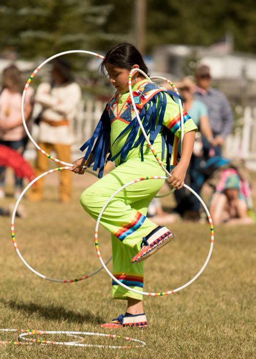 A boy participates in a tribal dance