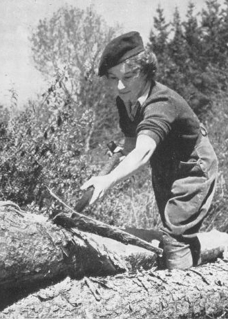 a woman chopping wood.
