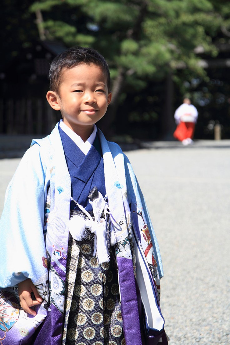 a young boy in traditional japanese fashion.