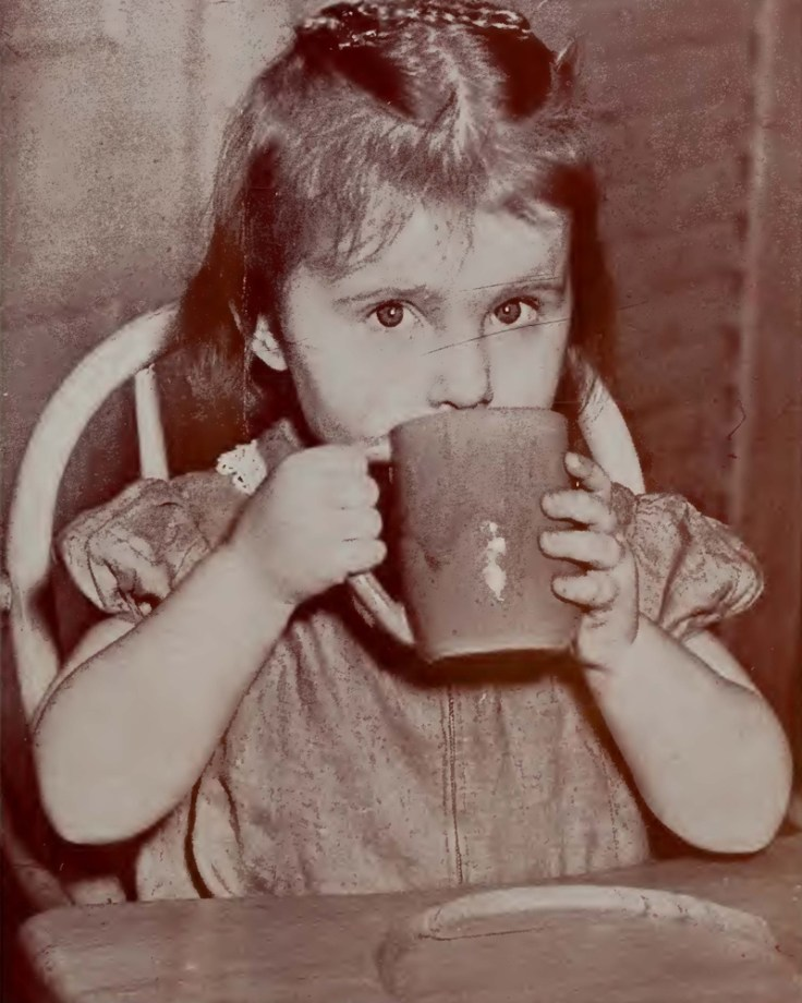 silent generation girl drinking from cup