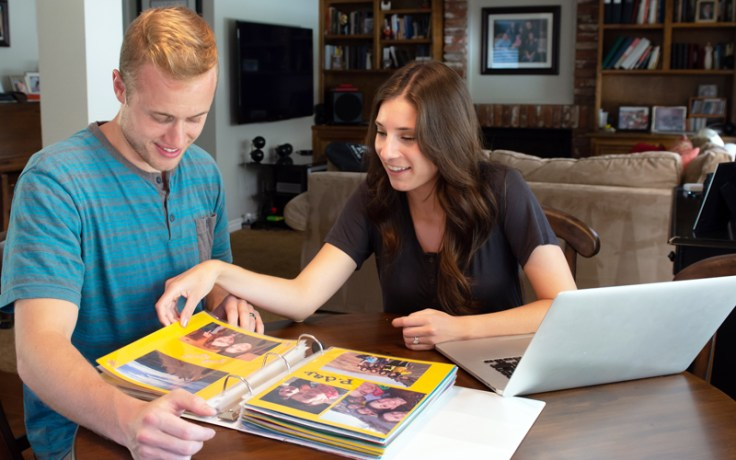A family looks at a photo album together