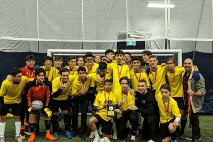 Team photo after the winning the south regional championship, lead by coach (on the right) Mr. Ferroni. (Photo submitted by Kevin Alika)