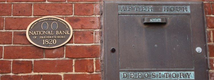 Pictured here is the historic building marker and the after hours depository