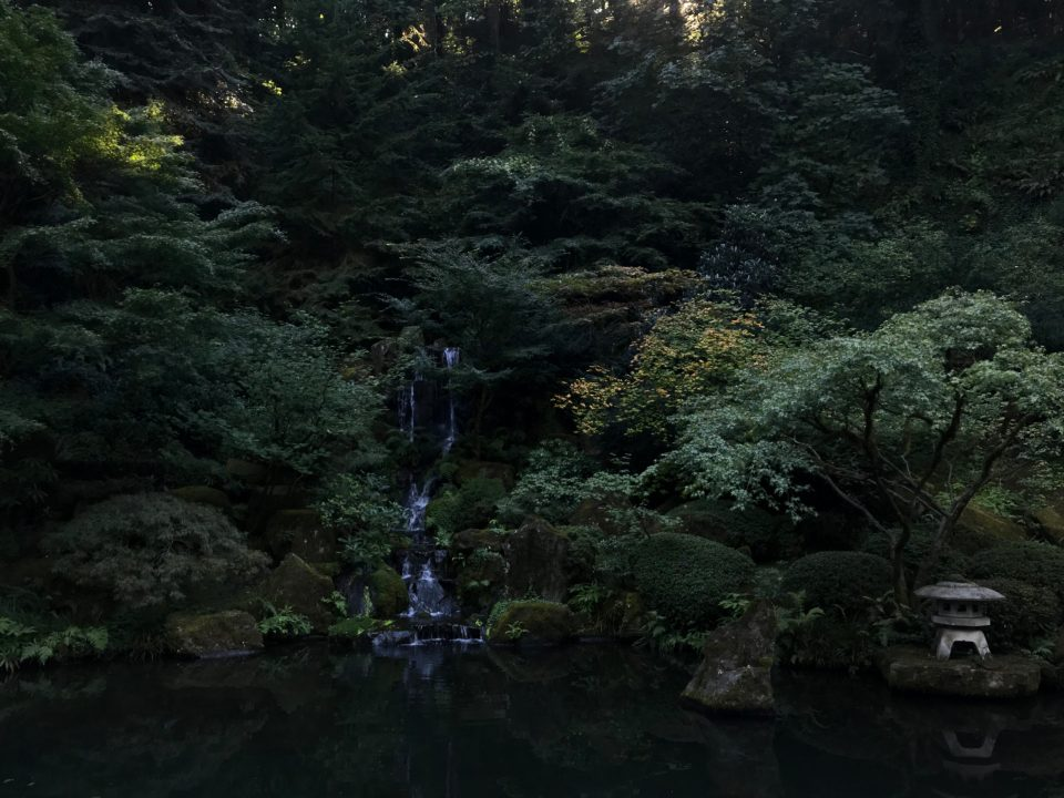 Photo of the Heavenly Falls at Portland Japanese Garden with a small amount of fall color.