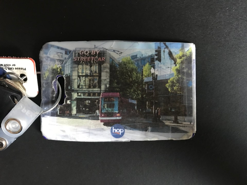 Photo of a custom Hop Fastpass card on a keychain.