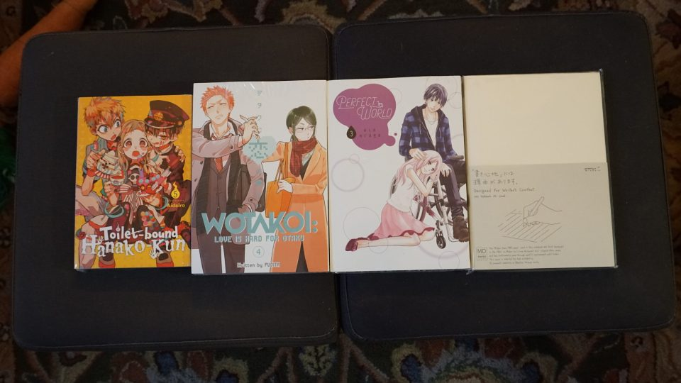 Photo of three new release manga from Kinokuniya and a Midori MD Notebook.