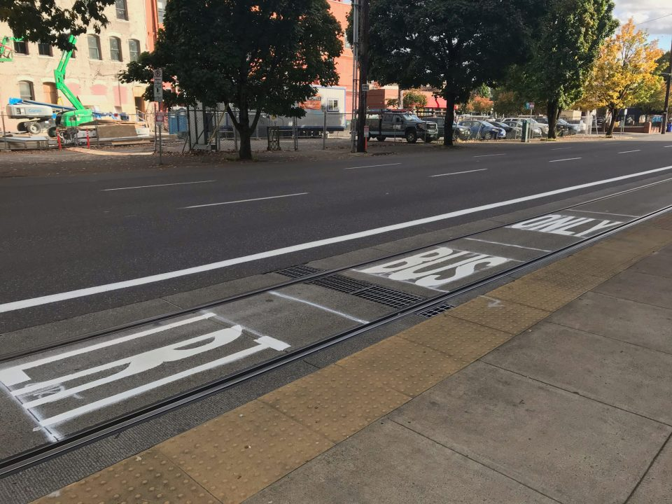 Photo of a newly-painted transit-only lane in Portland's Central Eastside.