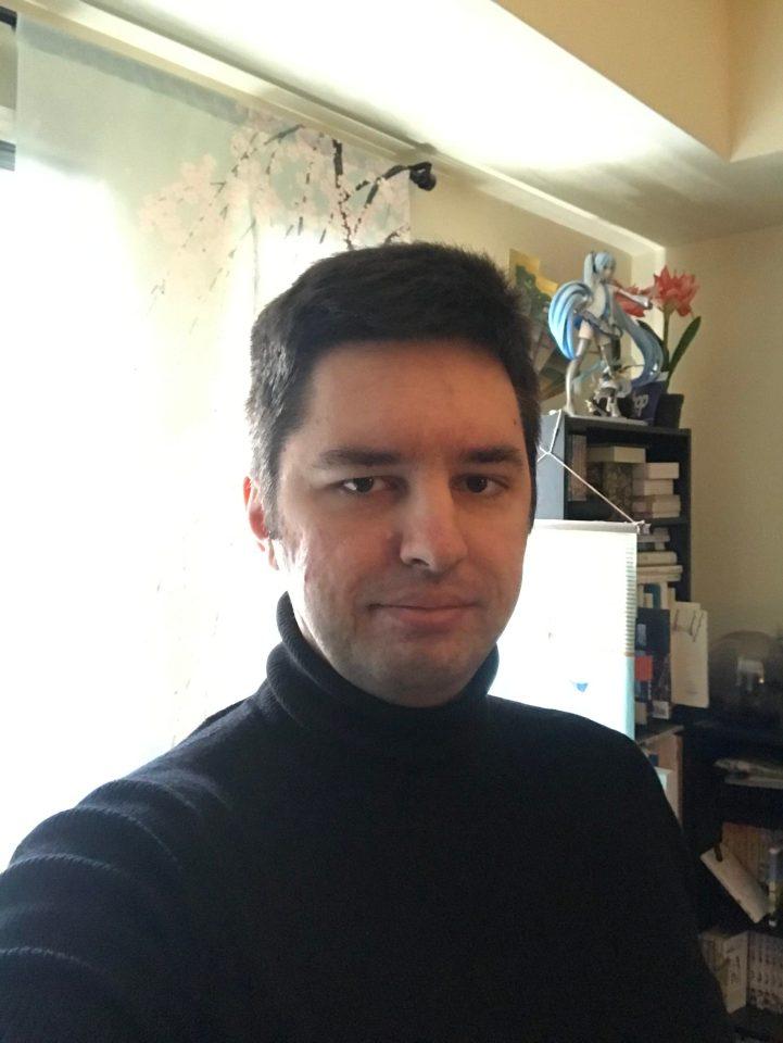 Selfie while wearing a black turtleneck.