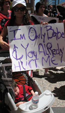 Alvarez with her youngest son, Daniel, during a march in August for the children of migrants detained during Arpaio's raids.