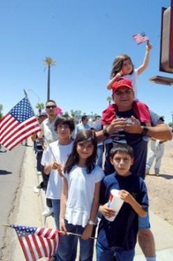 A family at Saturday's protest in Phoenix - Photo: José Muño