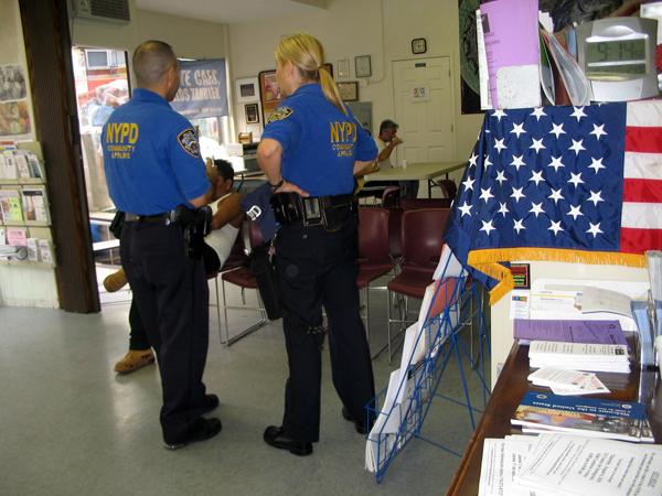 Cops checking in at El Centro, a Hispanic community center - Photo: Cristina DC Pastor