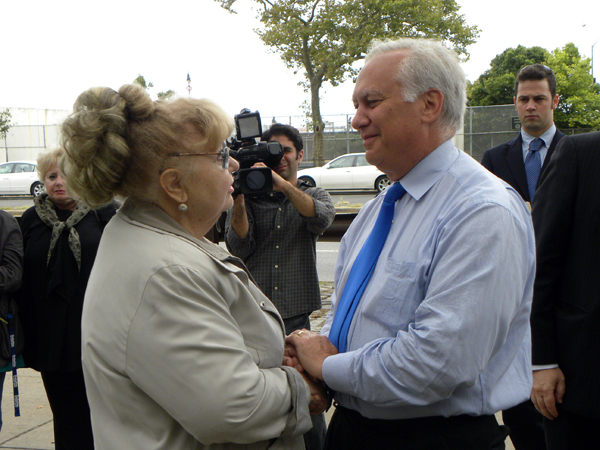 Assemblyman Richard Brodsky speaks with Nelly Braginsky who lost her son Alex on September 11th - Photo: Ewa Kern-Jedrykowska