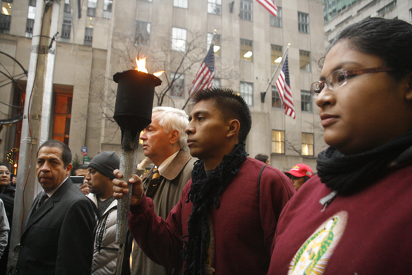 Torch bearers Javier Santos and Areceli Almaguer outside of Saint Patrick's Cathedral in New York - Photo: Sarah Kramer