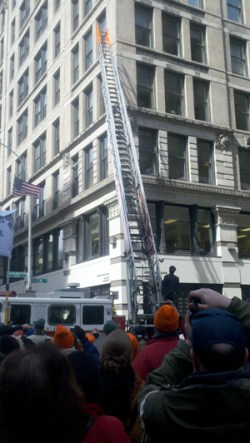 The ceremony included a reenactment of the fire department ladders only reaching the sixth floor of the burning factory building
