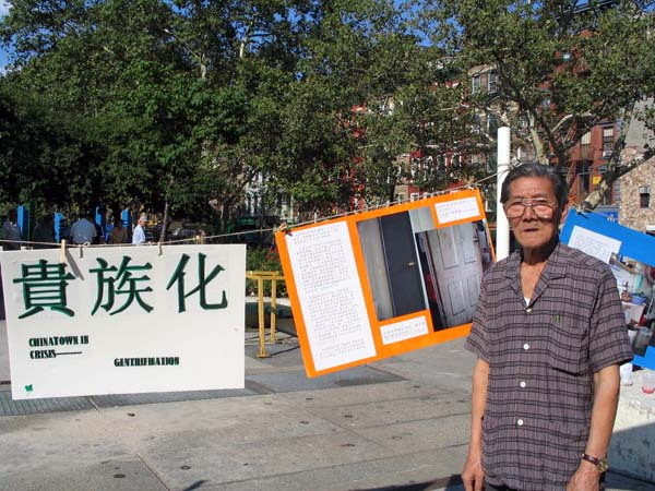A senior tenant in Chinatown at a street exhibition of gentrification in the neighborhood held by grassroots organizations in 2005