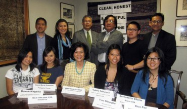 Loida Nicolas Lewis (in blue necklace) and grassroots activists.