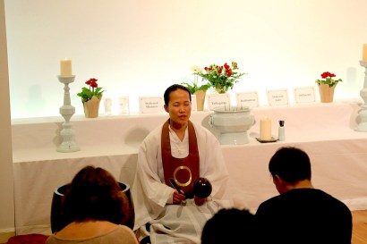 Doyeon Park, a Won Buddhist Monk, leads meditation in a temple.