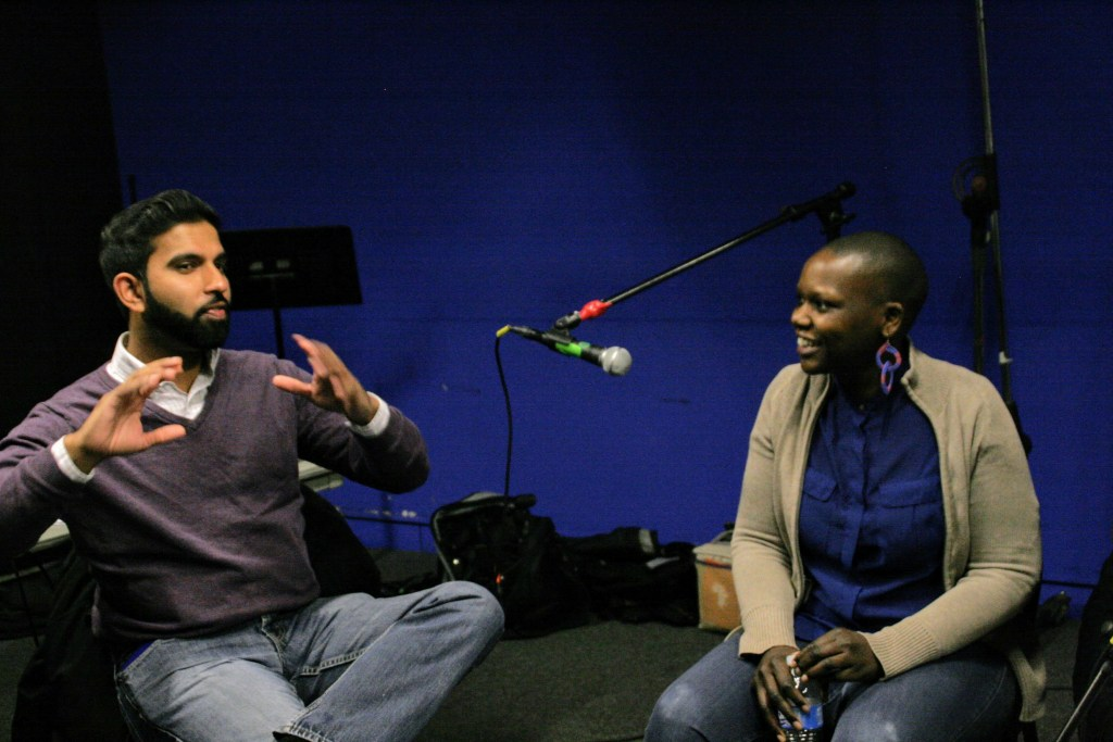 Peter Jacob makes a point as Agunda Okeyo looks on during the podcast recording at The New School. Photo: Stephanie Rodriguez