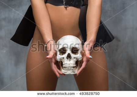 stock-photo-sexy-woman-holding-skull-between-her-legs-halloween-hot-party-concept-493828750
