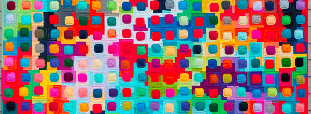 colorful quilt with rounded squares called squircles