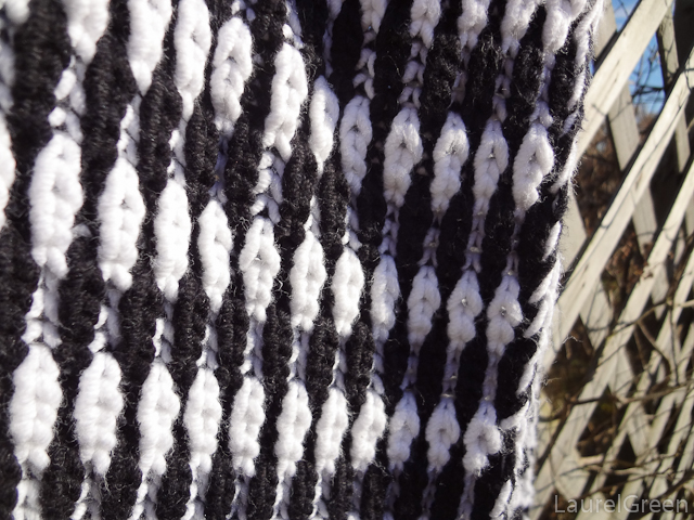 a photo of a close-up of two-colour syncopated brioche stitch
