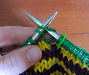 Begin Rnd 2: Knit into first loop of first stitch.