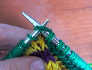 This is how it looks to knit the second loop and following first loop together.