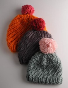 This Swirly Hat knit project can be made with just on skein - including the pom pom! If you want a contrast pom, two skeins will net you two hats. One for you and one for a gift!