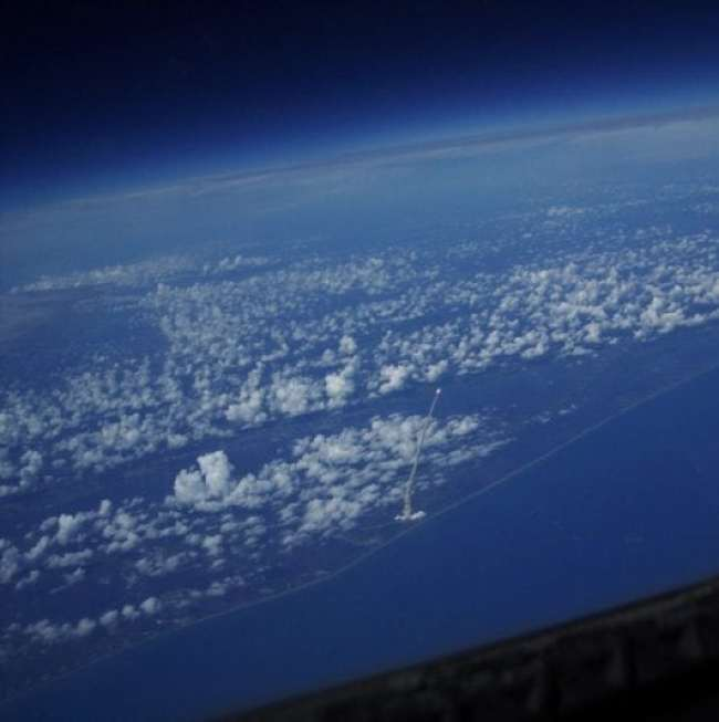 Shuttle launch view from a satellite