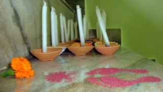 Candles sticking out of little terracotta bowls, to be put around the house. Actually, this is just to minimise the damage caused to the furniture due to the melting wax!