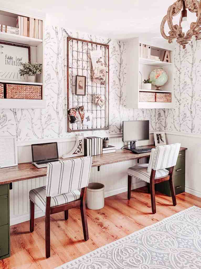 farmhouse office with diy desk, beadboard chair rail, and whimsical woods wallpaper