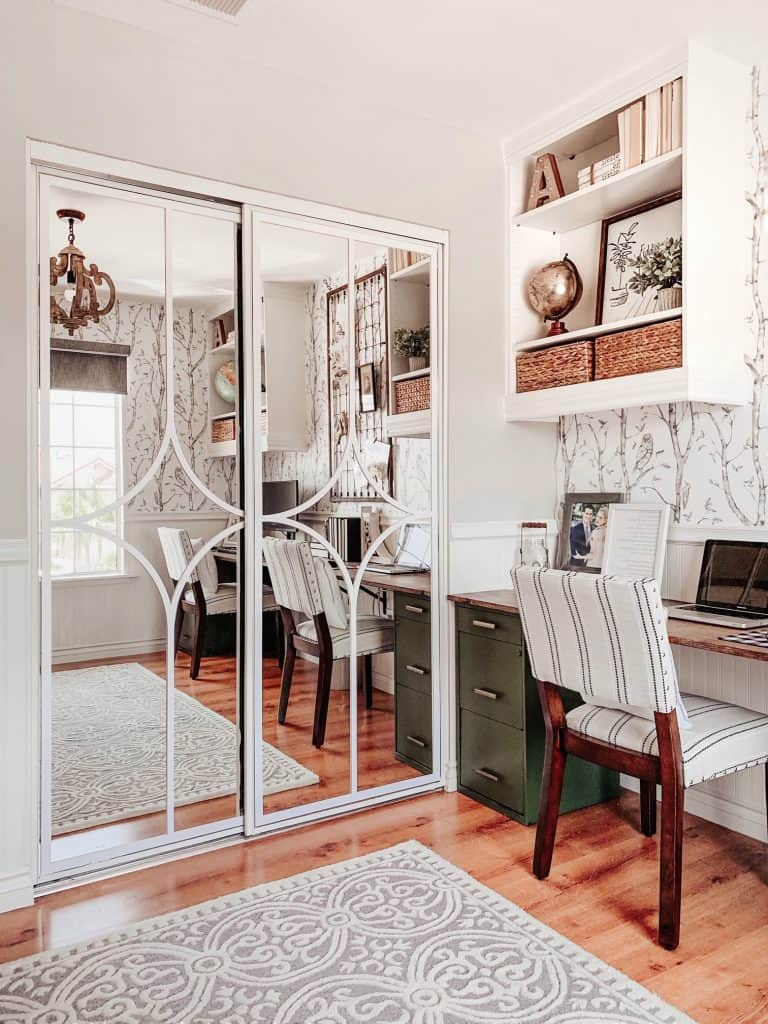 farmhouse office with beadboard chair rail, diy desk, and whimsical woods wallpaper
