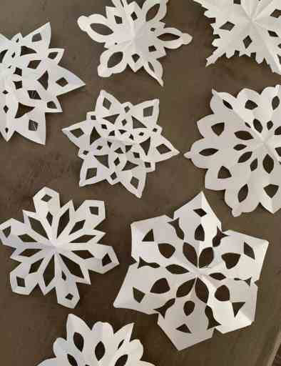 paper snowflakes with glitter
